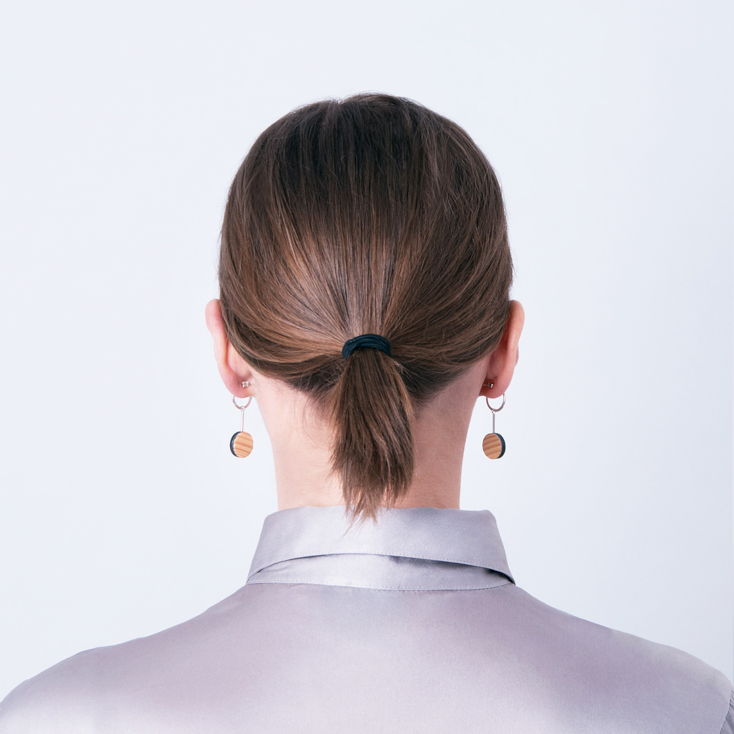 viilu_jewelry_helmi_earrings_pine_black_small_behind_model